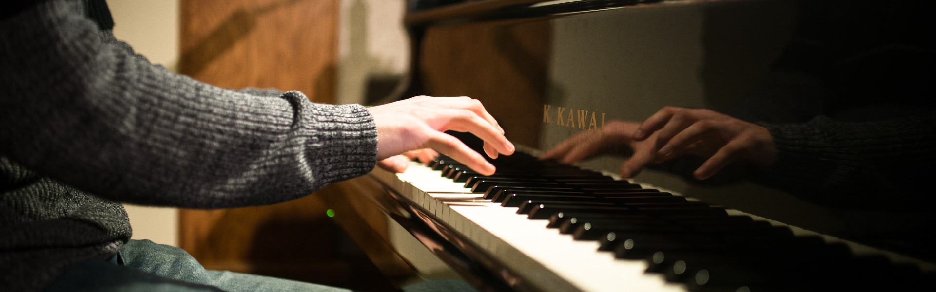 Closeup shot of a pianist playing the piano at Chapel