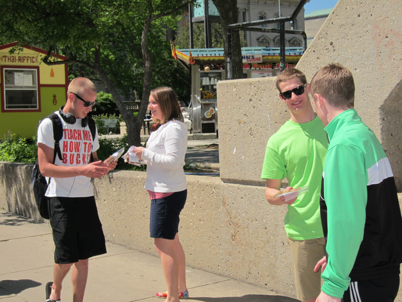 Chapel students hand out cookies to their fellow classmates on the UW-Madison campus at Library Mall