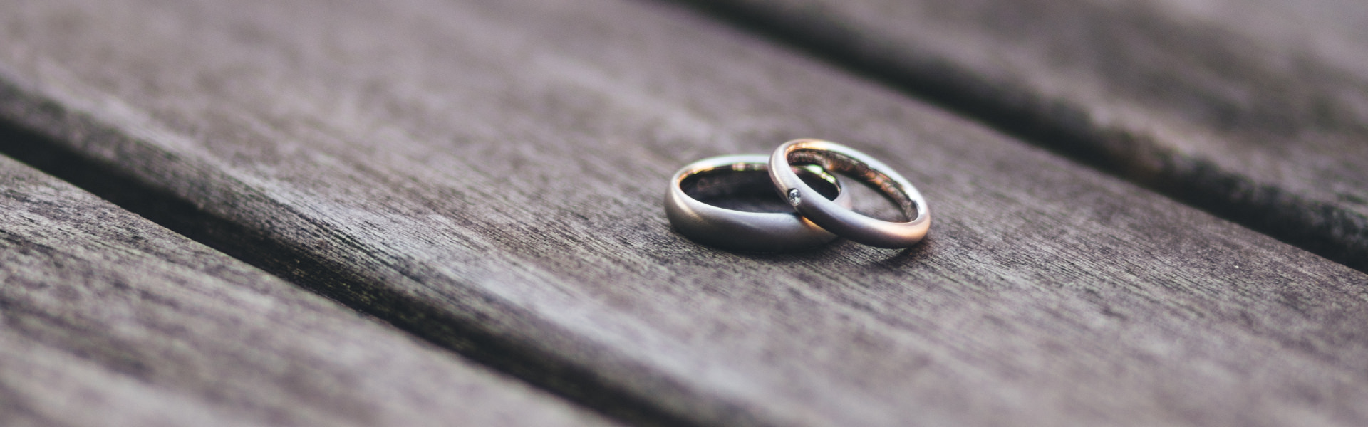 Pair of wedding rings on a plank board